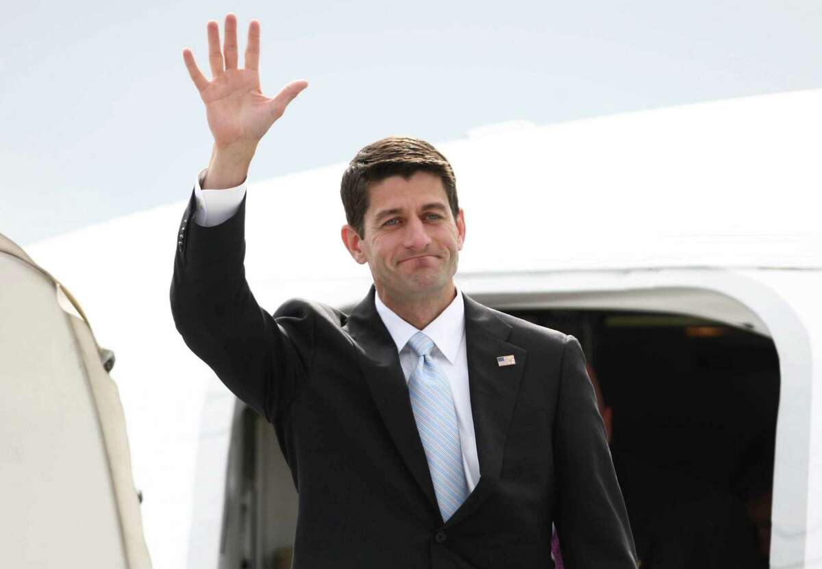 Paul Ryan, Republican nominee for vice president, waves as he departs a plane at Boeing Field during a visit to the Seattle area on Monday, September 10, 2012. Ryan is running with Mitt Romney and stopped in the area for a fundraiser.