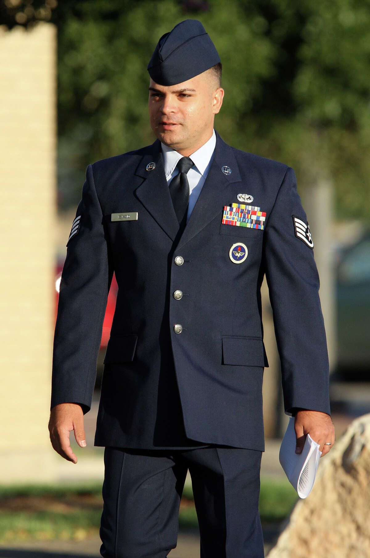 U.S. Air Force Staff Sgt. Kwinton Estacio, right, arrives for the start of his court marshal at Lackland Air Force Base, Monday, Sept. 10, 2012. Estacio is being tried on charges that he sexually assaulting a female basic training student, violating a no-contact order and asking several trainees to lie about his contact with them.
