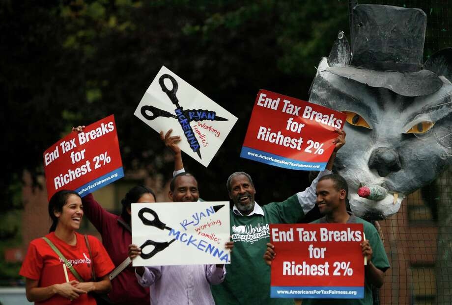 Protesters gather outside as Paul Ryan, Republican nominee for vice president, departs Boeing Field during a visit to the Seattle area on Monday, September 10, 2012. Ryan is running with Mitt Romney and stopped in the area for a fundraiser. Photo: JOSHUA TRUJILLO / SEATTLEPI.COM