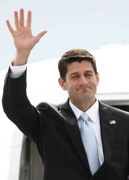Paul Ryan, Republican nominee for vice president, waves as he departs a plane at Boeing Field during