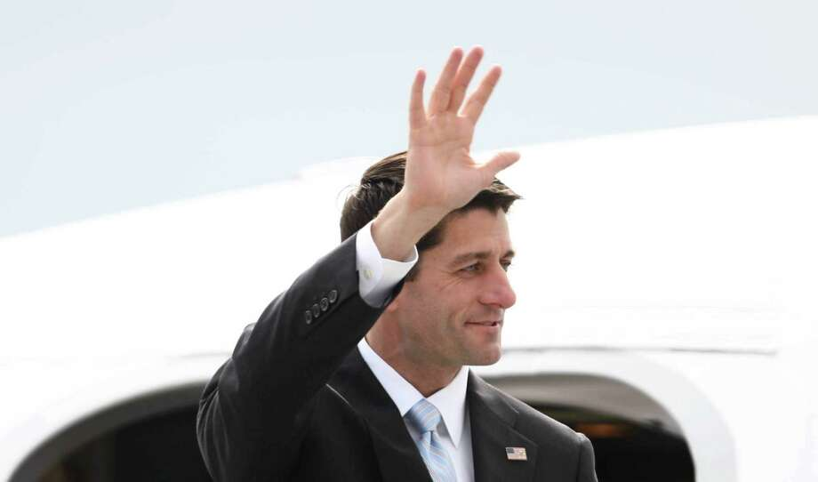 Paul Ryan, Republican nominee for vice president, waves as he departs a plane at Boeing Field during a visit to the Seattle area on Monday, September 10, 2012. Ryan is running with Mitt Romney and stopped in the area for a fundraiser. Photo: JOSHUA TRUJILLO / SEATTLEPI.COM