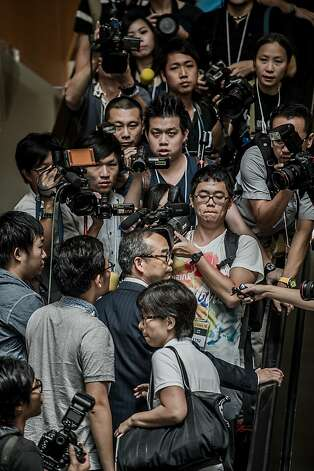 Lau Kong-wah (in suit) of the pro-Beijing Democratic Alliance leaves the ballot-counting center a loser. Photo: Philippe Lopez, AFP/Getty Images