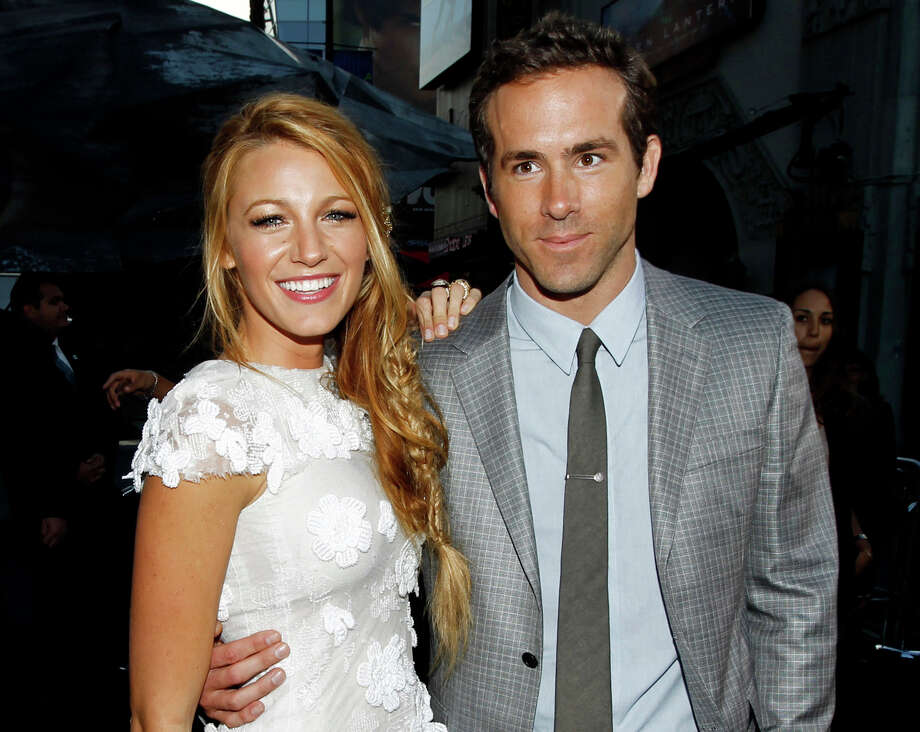 "FILE - This June 15, 2011 file photo shows actors Blake Lively, left, and Ryan Reynolds at the premiere of ""Green Lantern"" in Los Angeles. Reynolds wed Blake Lively in Mount Pleasant, S.C.,  Sunday, Sept. 9, 2012, at Boone Hall Plantation, according to a person familiar with the ceremony who requested anonymity because they were not authorized to speak on the matter. While it's Lively's first marriage, Reynolds was previously married to Scarlett Johansson. Their divorce was finalized last summer after three years of marriage. Lively and Reynolds both starred in last year's ""Green Lantern."" (AP Photo/Matt Sayles, file) Photo: Matt Sayles"