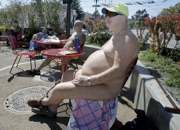 Naked: The guys who hang out  at San Francisco's Castro and Market streets aren't exactly models for Michaelangelo. but they started a debate that culminated in a citywide ban on public nudity--except at festivals.  Photo: Brant Ward, The Chronicle