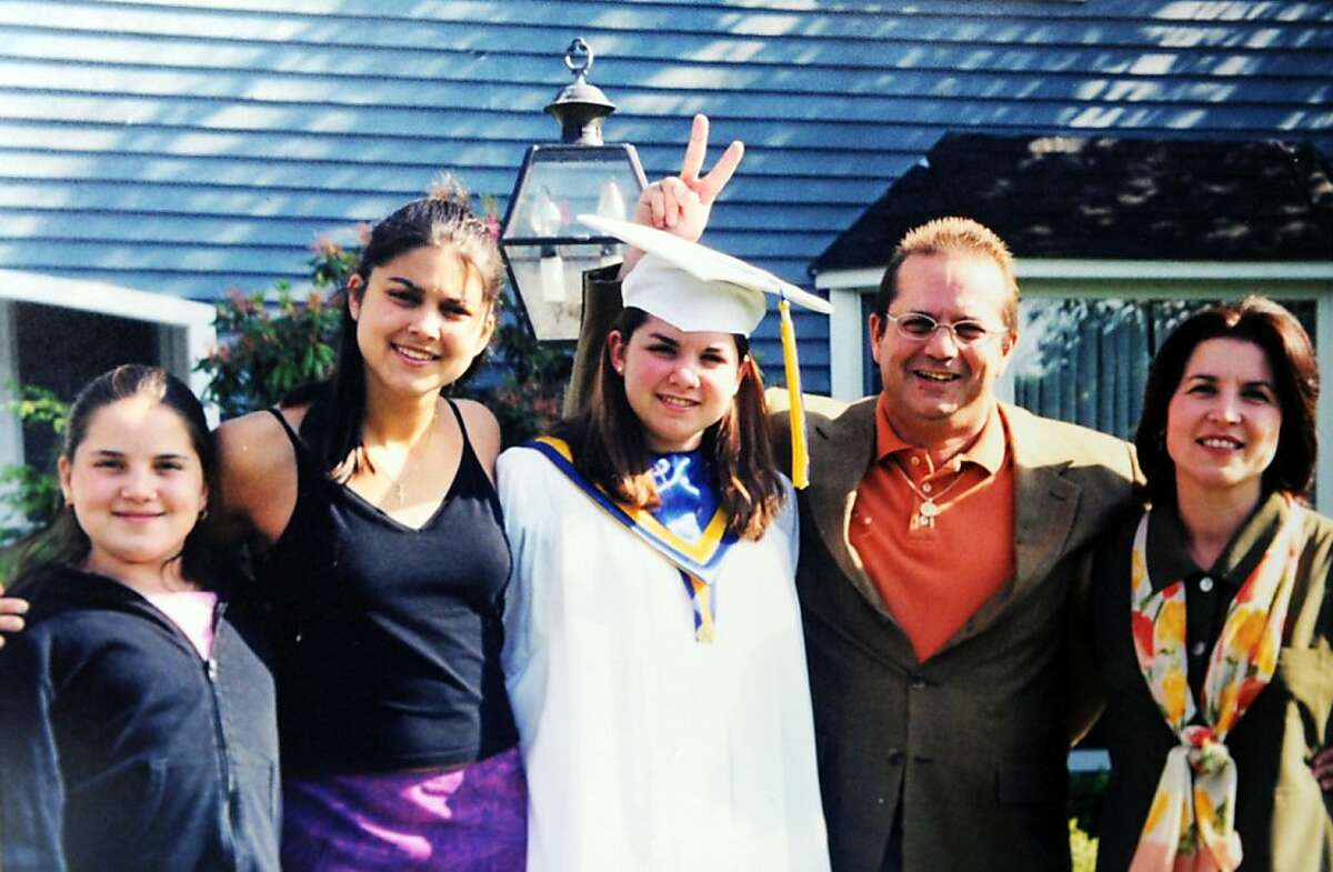 Pictured in a family photo, from left, are Alexandra, Jessica, Rebecca, Randy, and Denise Scott. The Scott family recently received a letter Randy wrote and threw from a window of Two World Trade Center before he died. The family has loaned the letter to the National September 11 Memorial & Museum.