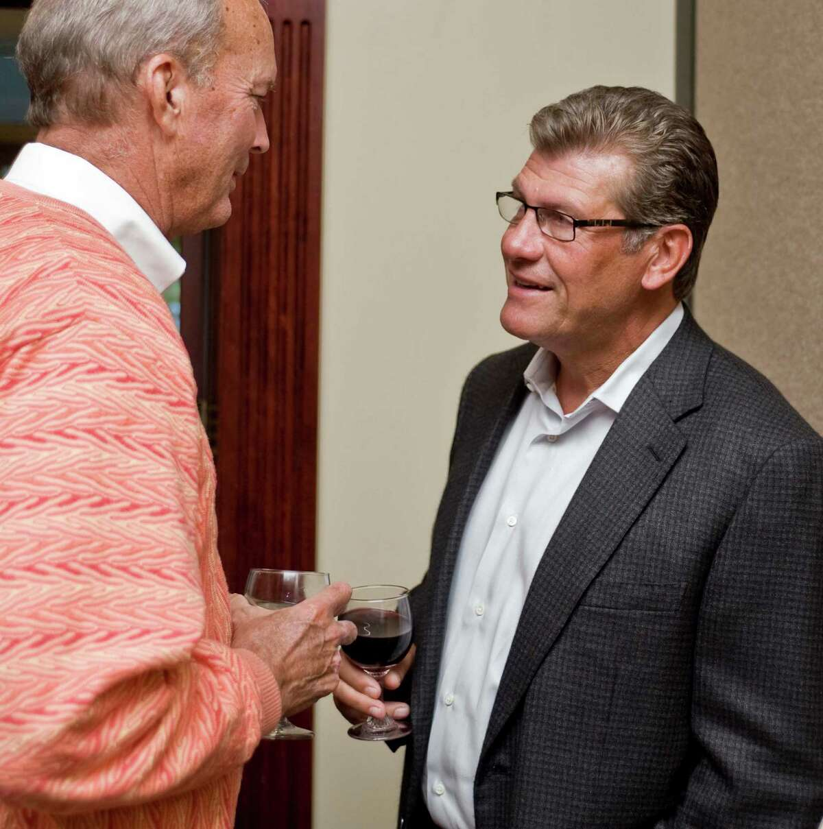 Philip Lodewick of Ridgefield chats with UConn women's basketball coach Geno Auriemma at the Amber Room Colonnade in Danbury where Coach Auriemma spoke at the UCONN Alumni Association dinner. Monday, Sept. 10, 2012