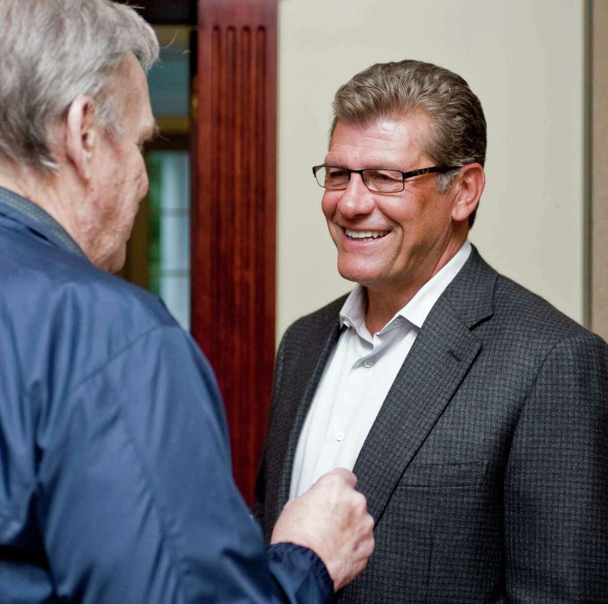 Doug Bussing came up from Norwalk to talk with UConn women's basketball coach Geno Auriemma at the Amber Room Colonnade in Danbury, where Coach Auriemma spoke at the UCONN Alumni Association dinner. Monday, Sept. 10, 2012