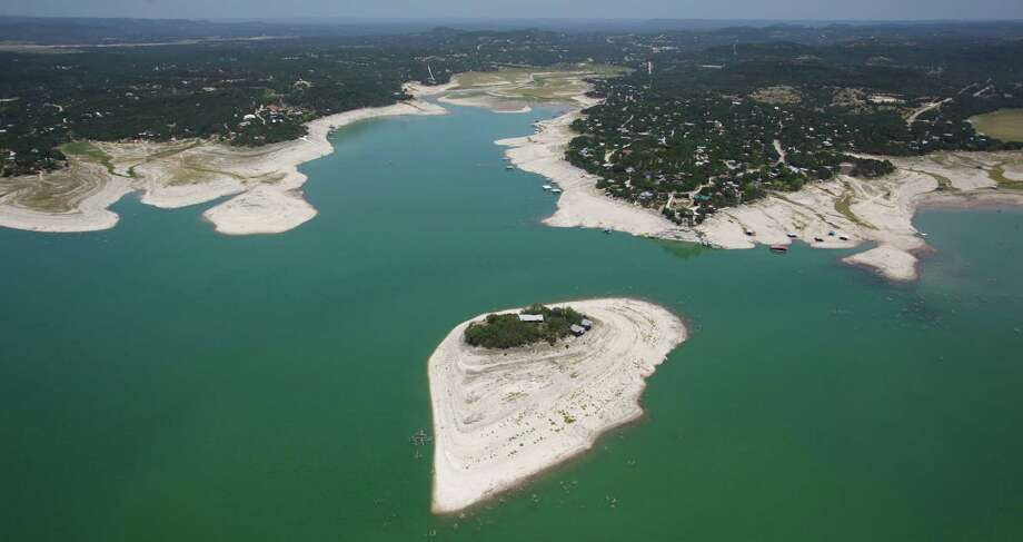 The island in Medina Lake is seen in a Wednesday Aug. 1, 2012 aerial image. The Texas Water Development Board's website reports the lake is 59.39 feet low and is currently only 16.22 percent full. At normal pool elevation the lake's water line rises all the way to the trees on the island. Photo: William Luther, San Antonio Express-News / © 2012 San Antonio Express-News