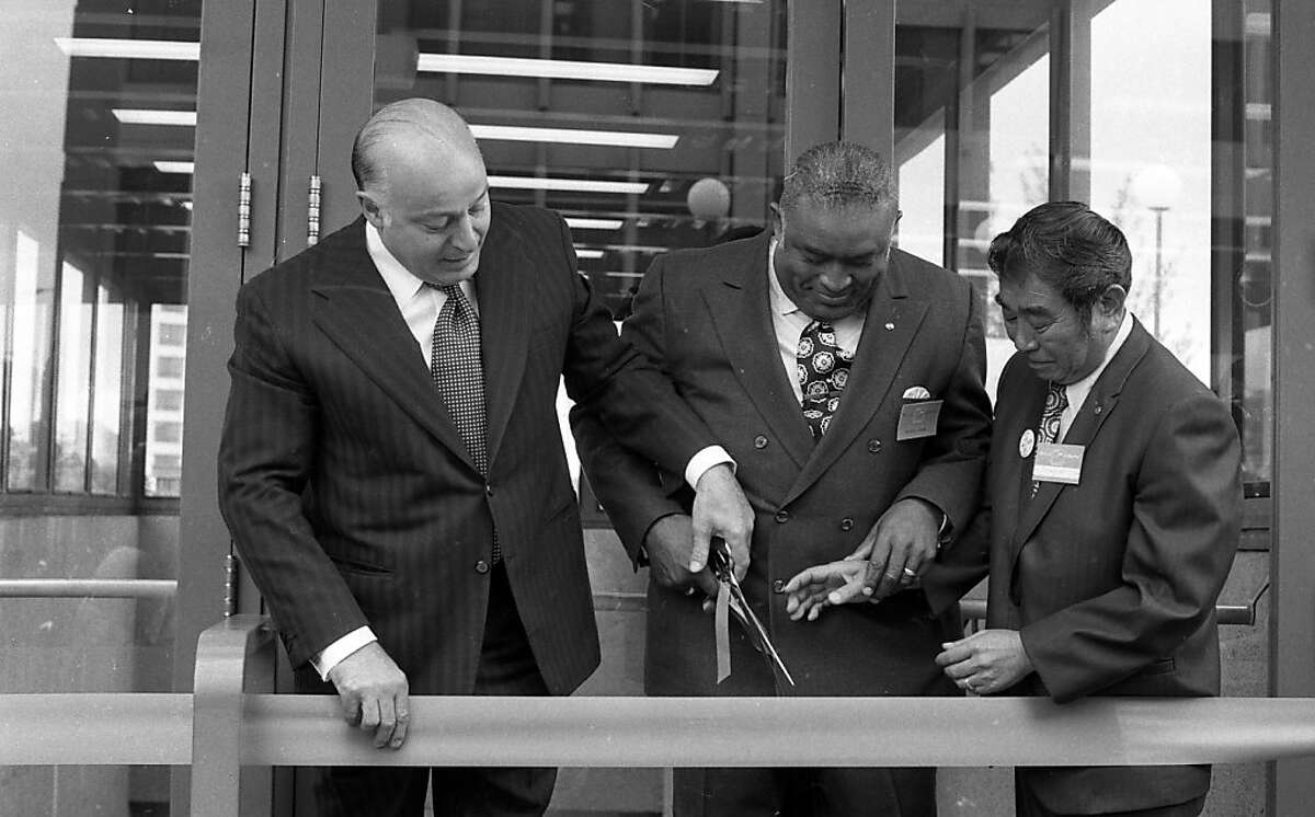 San Francisco Mayor, Joseph Alioto, left, BART Vice President, William Chester, and Oakland Vice Mayor, Frank Ogawa, cutting the ribbon at the Lake Merritt BART station on in September 1972.