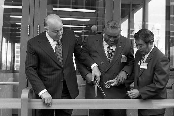 San Francisco Mayor, Joseph Alioto, left, BART Vice President, William Chester, and Oakland Vice Mayor, Frank Ogawa, cutting the ribbon at the Lake Merritt BART station on Monday, September 1972. BART, the transit system that covers most of the Bay Area is 40-years-old this year.