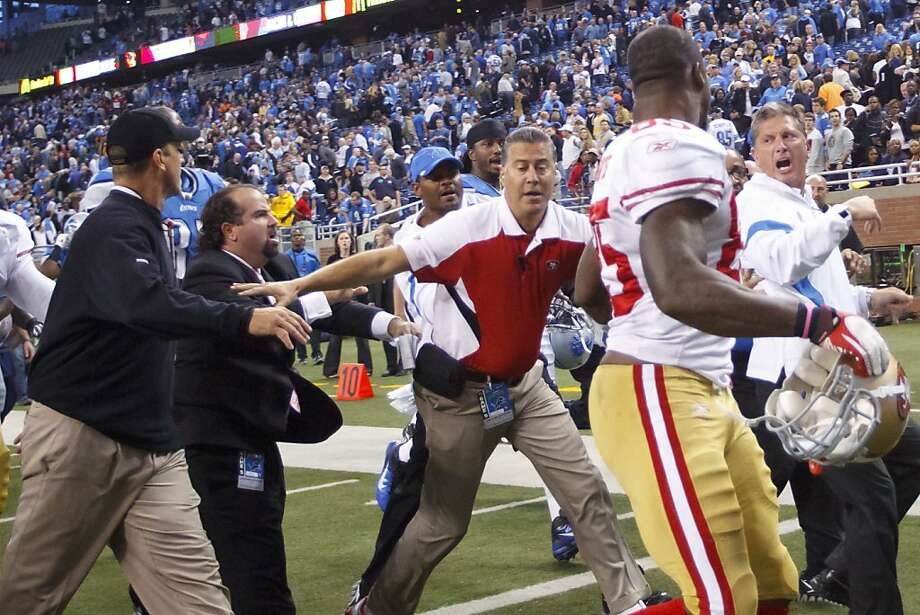 49ers head coach Jim Harbaugh and the Lions' Jim Schwartz exchanged more than a handshake after last year's game. Photo: Rick Osentoski, Associated Press