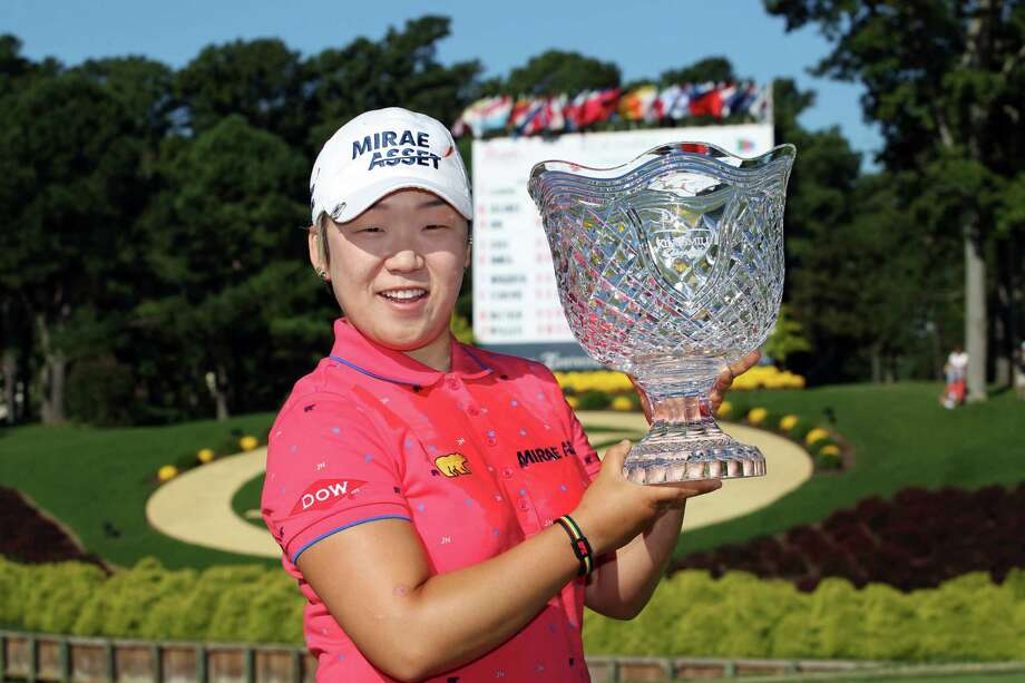 WILLIAMSBURG, VA - SEPTEMBER 10: Jiyai Shin of South Korea holds the championship trophy after winning the Kingsmill Championship at Kingsmill Resort on September 10, 2012 in Williamsburg, Virginia. (Photo by Hunter Martin/Getty Images) Photo: Hunter Martin / 2012 Getty Images