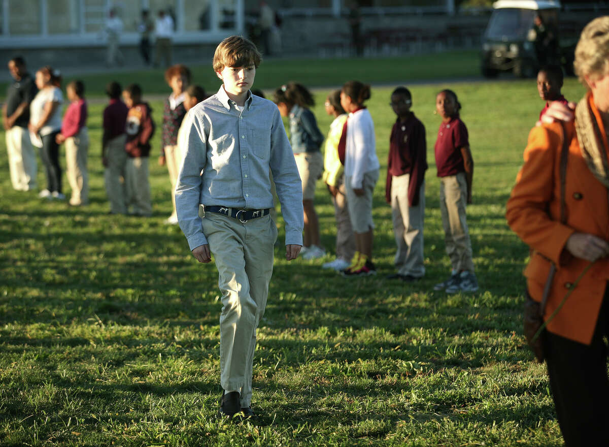 Christopher Gardner, 14 of Darien, son of 9/11 victim Christopher Gardner, walks stoically by himself in the procession at the annual 9/11 memorial service at Sherwood Island State Park in Westport on Monday, September 10, 2012.