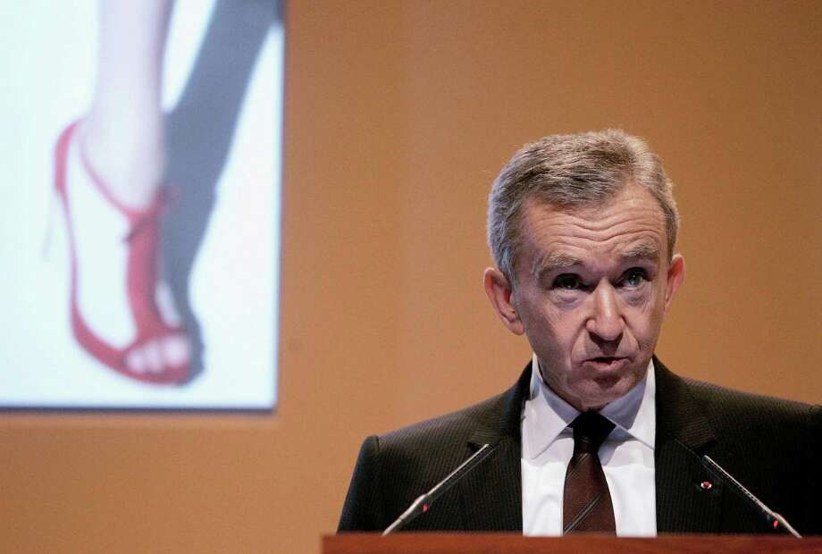 Bernard Arnault. the richest man in Europe, may be headed to Belgium to avoid a plan by the French president to tax high earners at 75 percent. Photo: Michel Euler / AP