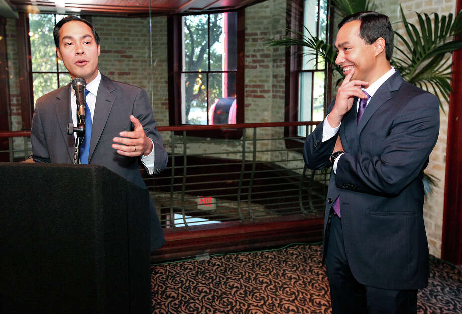 Mayor Julián Castro (left) speaks as his twin brother congressional candidate Joaquín Castro listens during a fund-raiser for Joaquín held Monday Sept. 10, 2012, at Ruth's Chris Steak House. Photo: Edward A. Ornelas, San Antonio Express-News / © 2012 San Antonio Express-News