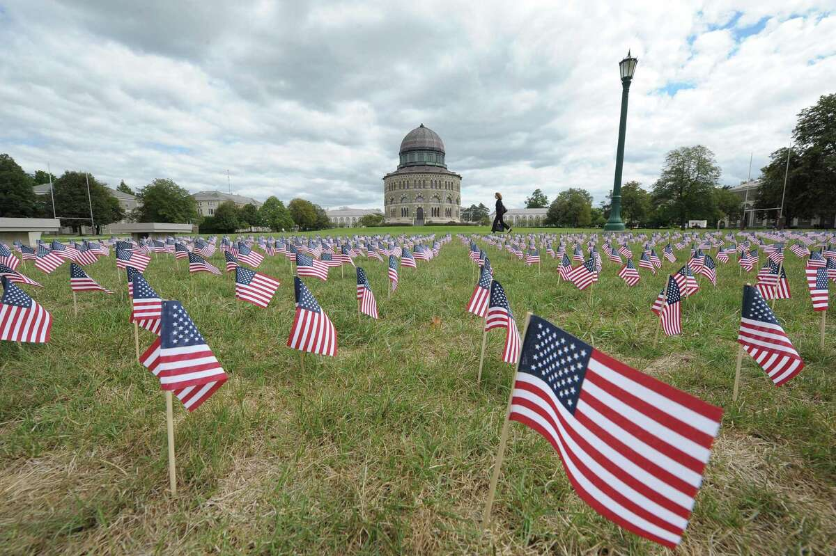Union College students in the College Republicans and the College Democrats groups have planted 2,000 small American flags as a memorial to mark the 9/11 anniversary, as seen here on Monday afternoon, Sept. 10 2012 in Schenectady, NY. (Paul Buckowski / Times Union)