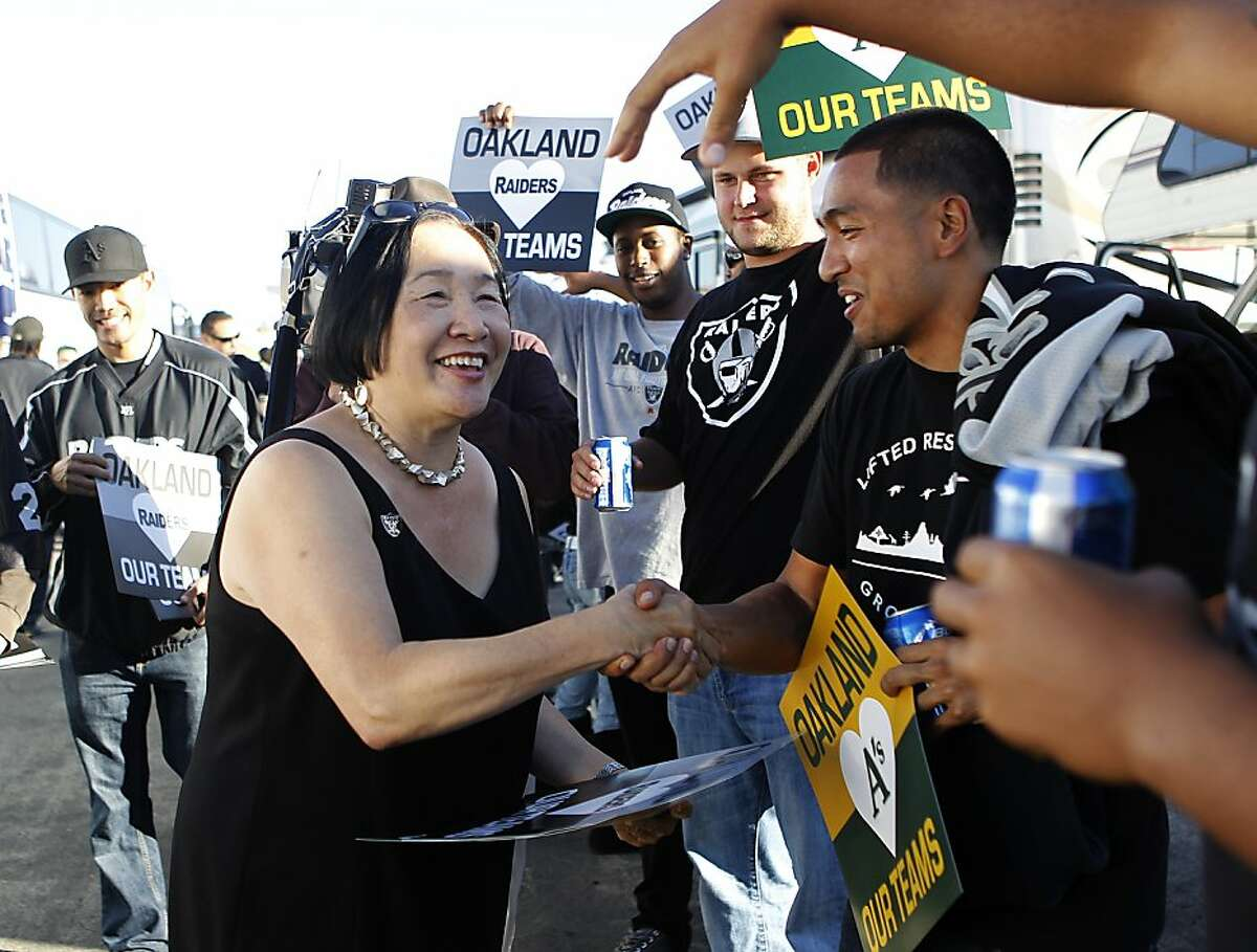 Mayor Jean Quan greets Oakland Raiders fans before the game against the San Diego Chargers in Oakland, Calif. on Monday, Sept. 10, 2012.