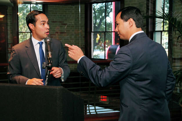 Mayor Julián Castro (left) and his twin brother congressional candidate Joaquín Castro talk during a fund-raiser for Joaquín held Monday Sept. 10, 2012, at Ruth's Chris Steak House. Photo: Edward A. Ornelas, San Antonio Express-News / © 2012 San Antonio Express-News