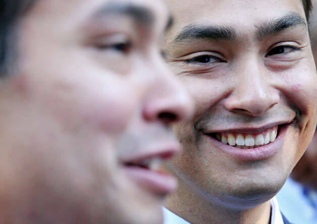 Congressional candidate Joaquin Castro (right) listens as his twin brother Mayor Julian Castro answers questions from the media during a welcome home and birthday party celebration held Monday Sept. 10, 2012 at Sunset Station. The twins will be 38-years-old on Sept. 16. Photo: Edward A. Ornelas, San Antonio Express-News / © 2012 San Antonio Express-News