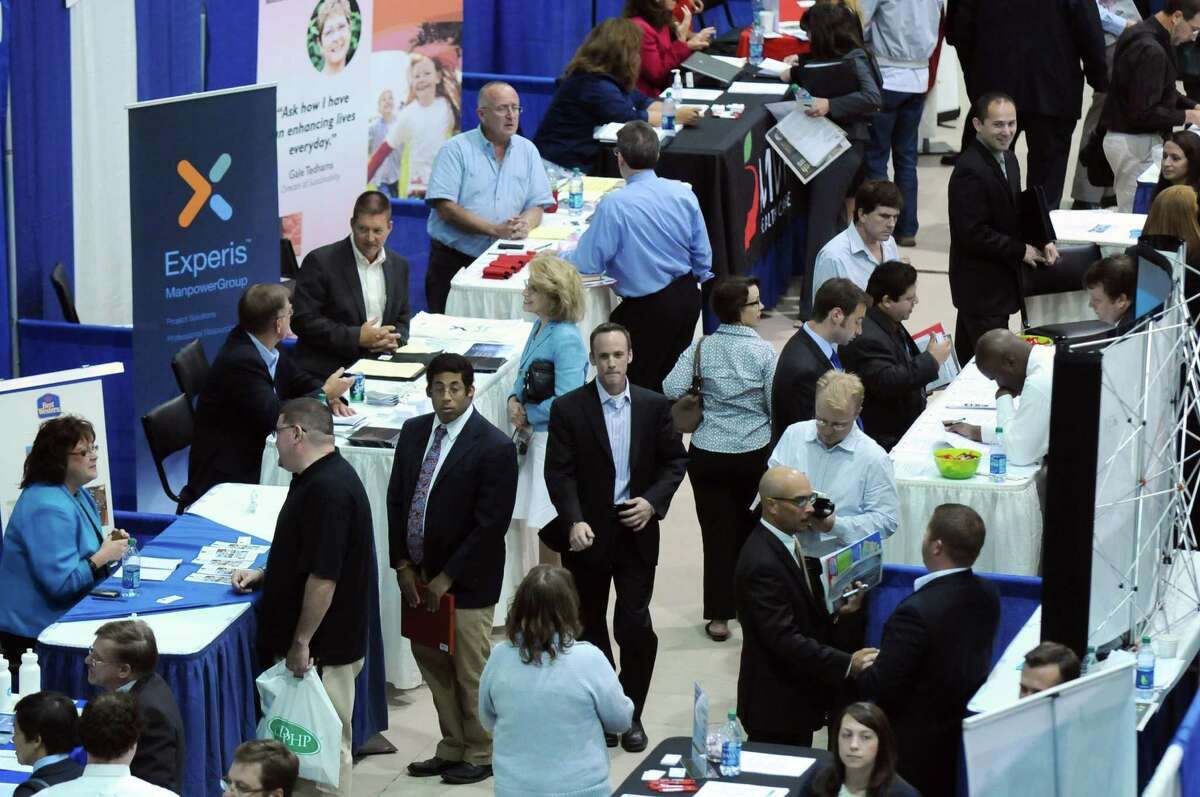 Vendors speaks to attendees of the Tech Career Expo at the SEFCU Arena at UAlbany on Monday Sept. 10, 2012 in Albany, NY. (Philip Kamrass / Times Union)
