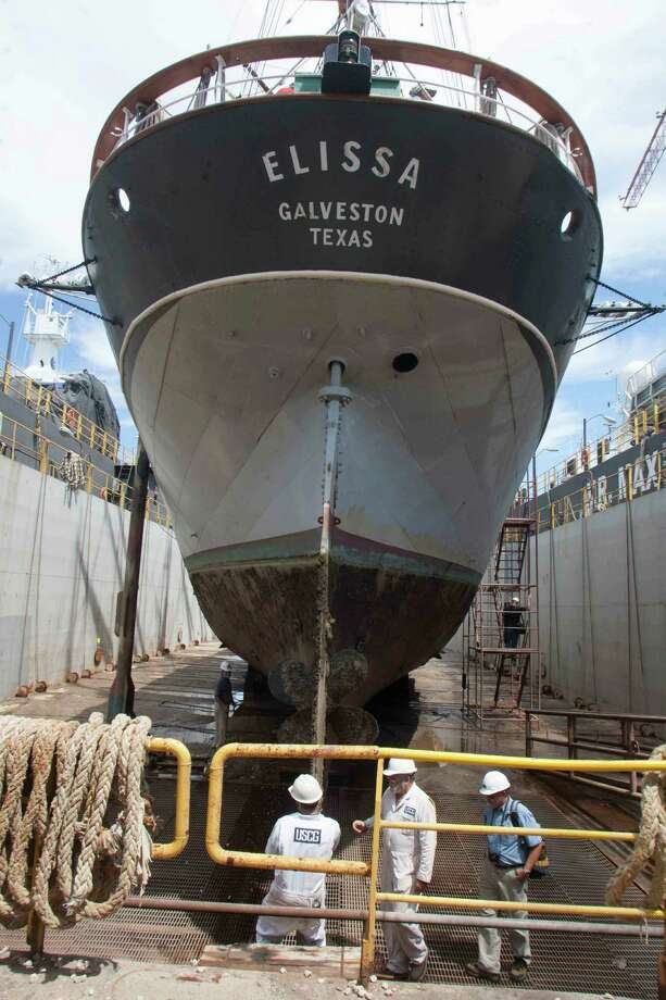 Work crews at a dry dock in Texas City take a look at the Elissa on Monday. The ship's iron hull is nearly eaten through in places because of unusually rapid corrosion caused when bacteria was churned up by Hurricane Ike. Photo: J. Patric Schneider / © 2012 Houston Chronicle