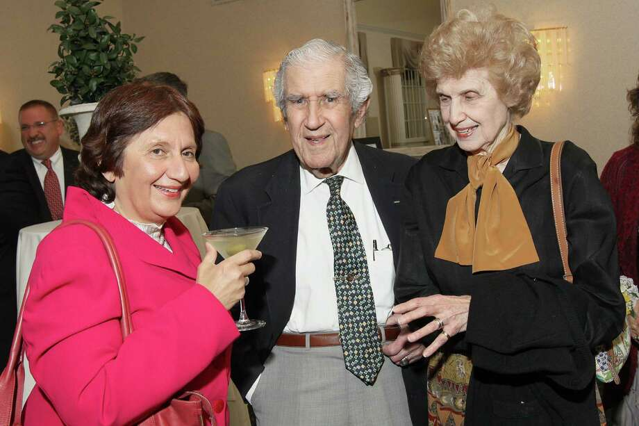 Albany, NY - March 22, 2012 - (Photo by Joe Putrock/Special to the Times Union) - Criminal defense lawyer Cheryl Coleman(left) talks with former Albany County District Attorney Sol Greenberg(center) and his wife Bea(right) during The Carol DeMare Tribute Dinner to benefit the Little Sisters of the Poor in Albany. Photo: Joe Putrock / Joe Putrock