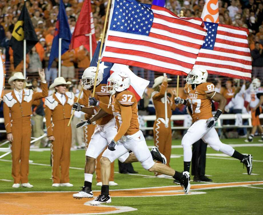 A fitting flag bearer, Nate Boyer (37) was awarded the Bronze Star for his service in Iraq before becoming a walk-on and eventually a scholarship player at Texas.