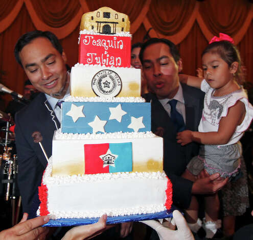 Congressional candidate Joaquín Castro (left) and his twin brother Mayor Julián Castro with his daughter Carina, 3, blow out candles on a cake during a welcome home and birthday party celebration held Monday Sept. 10, 2012 at Sunset Station. The twins will be 38 years old on Sept. 16. Photo: Edward A. Ornelas, San Antonio Express-News / © 2012 San Antonio Express-News