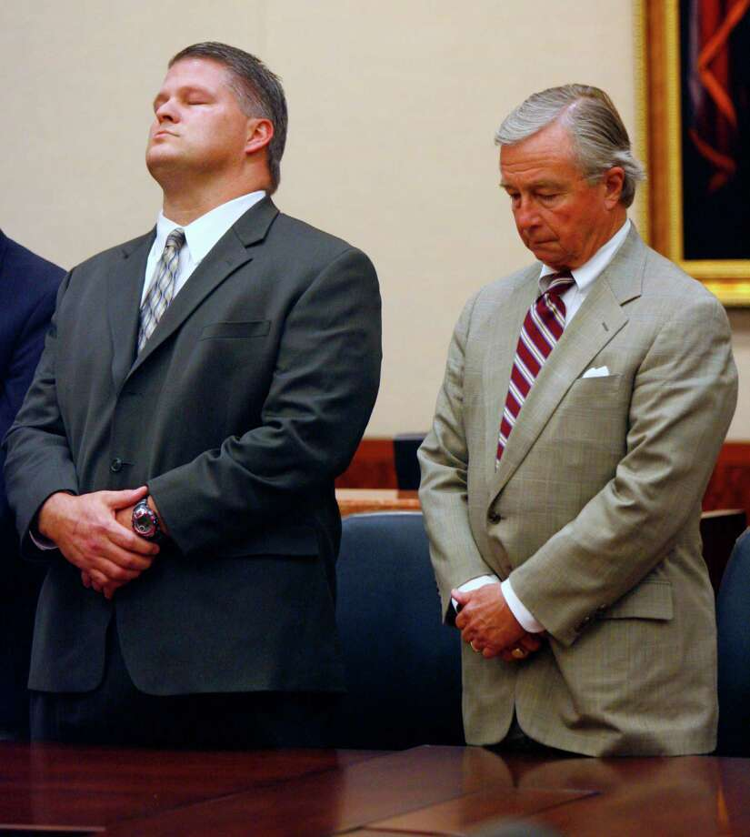 David Mark Temple, left, and his attorney, Dick DeGuerin, listen on Nov. 15, 2007, as the guilty verdict is read. Photo: Steve Ueckert / Houston Chronicle