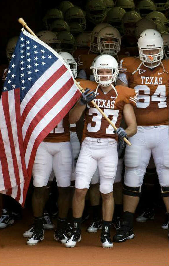 Nate Boyer, a Green Beret, leads the Longhorns onto the field against Wyoming in 2010. Courtesy photo / Texas Athletics Photo: Express-News