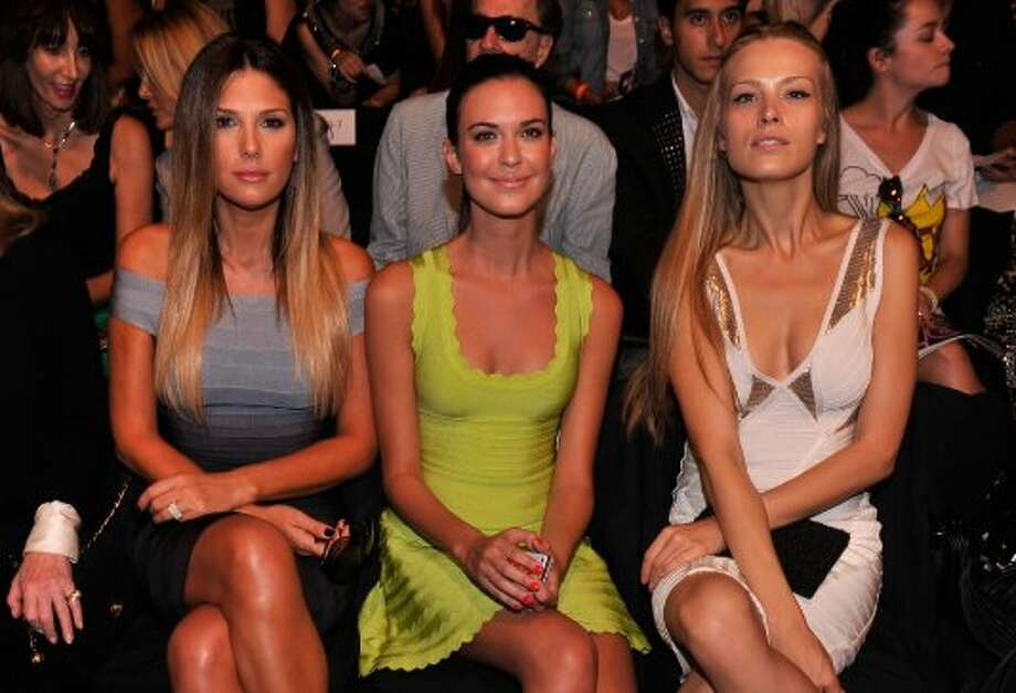 (L-R) Daisy Fuentes, actress Odette Annable and model Petra Nemcova attend the Herve Leger By Max Azria Spring 2013 show during Mercedes-Benz Fashion Week. (Stephen Lovekin / 2012 Getty Images)