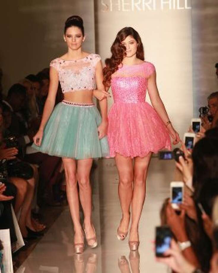 Sisters Kendall and Kylie Jenner walk the runway at the Evening Sherri Hill spring 2013 show during Mercedes-Benz Fashion Week. (Taylor Hill / Getty Images)