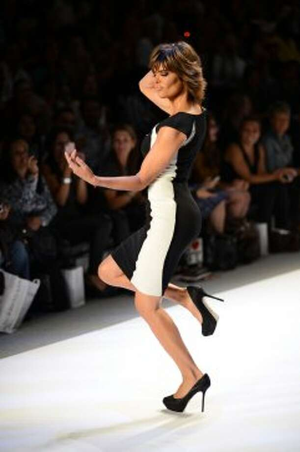 Lisa Rinna walks the runway during Strut: The Fashionable Mom show during Mercedes-Benz Fashion Week. (Andrew H. Walker / 2012 Getty Images)