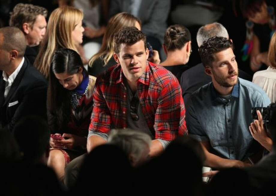 NBA Player Kris Humphries (C) attends the Lacoste Spring 2013 show during Mercedes-Benz Fashion Week. (Chelsea Lauren / 2012 Getty Images)