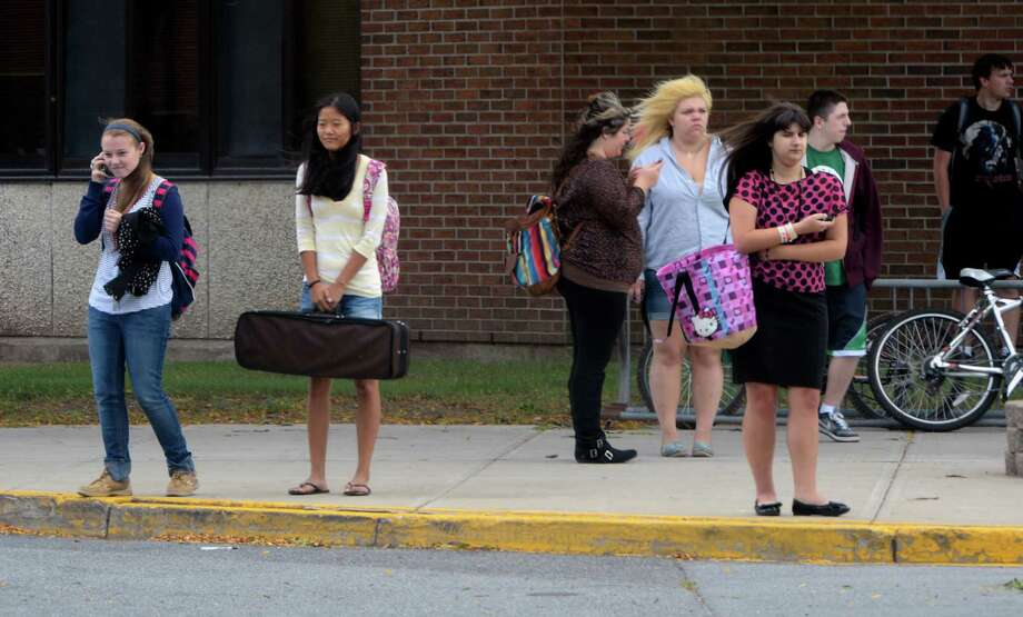 Students are on their cell phones immediately upon dismissal at the East Building of Shenendahowa High School in Clifton Park, N.Y.  Sept 10, 2012.     (Skip Dickstein/Times Union) Photo: Skip Dickstein / 00019205A