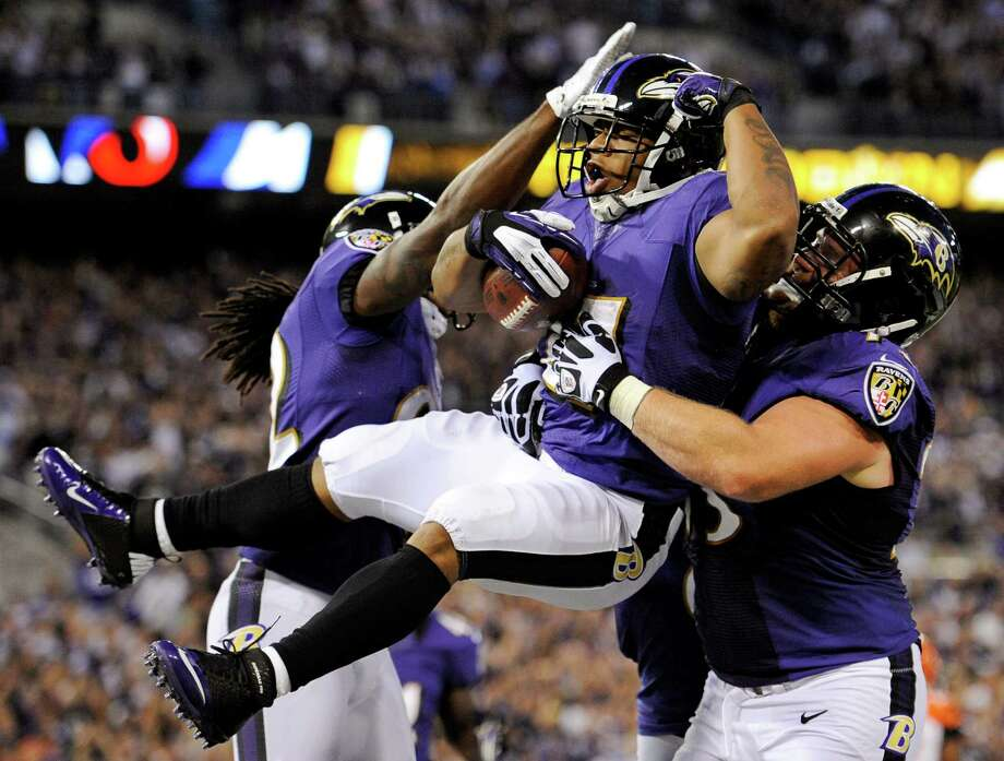 Baltimore Ravens running back Ray Rice, center, celebrates his touchdown with Torrey Smith, left, and Marshal Yanda in the first half of an NFL football game against the Cincinnati Bengals in Baltimore, Monday, Sept. 10, 2012. (AP Photo/Nick Wass) Photo: Nick Wass / FR67404 AP