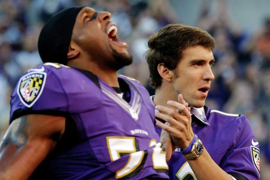If you are Ray Lewis it is great to have Olympic swimming legend Michael Phelps on your side. Photo: Patrick Semansky / AP