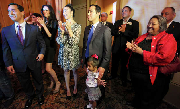Congressional candidate Joaquin Castro (from left) his girlfriend Anna Flores, Erica Castro, Mayor Julian Castro their daughter Carina, 3, and the twins mom Rosie Castor wait to take the stage during a welcome home and birthday party celebration held Monday Sept. 10, 2012 at Sunset Station. The twins will be 38-years-old on Sept. 16. Photo: Edward A. Ornelas, San Antonio Express-News / © 2012 San Antonio Express-News