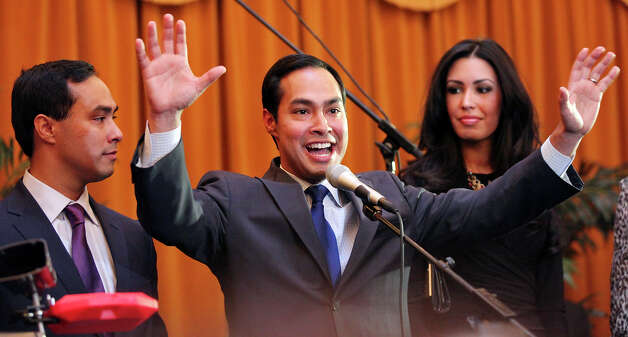 Congressional candidate Joaquín Castro (left) and his twin brother Mayor Julián Castro speak at a welcome home and birthday party celebration held Monday Sept. 10, 2012, at Sunset Station. The twins will be 38 years old on Sept. 16. Joaquin's girlfriend Anna Flores is pictured in background. Photo: Edward A. Ornelas, San Antonio Express-News / © 2012 San Antonio Express-News
