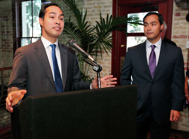 Mayor Julian Castro (left) speaks as his twin brother congressional candidate Joaquin Castro listens during a fund-raiser for Joaquin held Monday Sept. 10, 2012 at Ruth's Chris Steak House. Photo: Edward A. Ornelas, San Antonio Express-News / © 2012 San Antonio Express-News
