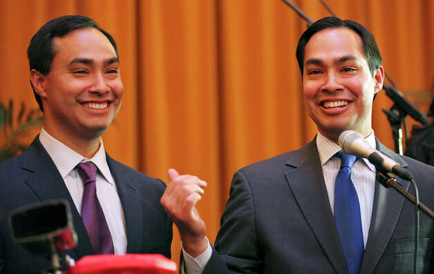 Congressional candidate Joaquin Castro (left) and his twin brother Mayor Julian Castro speak at a welcome home and birthday party celebration held Monday Sept. 10, 2012 at Sunset Station. The twins will be 38-years-old on Sept. 16.  Julian's wife is Erica Julian's daughter Carina Joaquin's girlfriend Anna Flores Photo: Edward A. Ornelas, San Antonio Express-News / © 2012 San Antonio Express-News