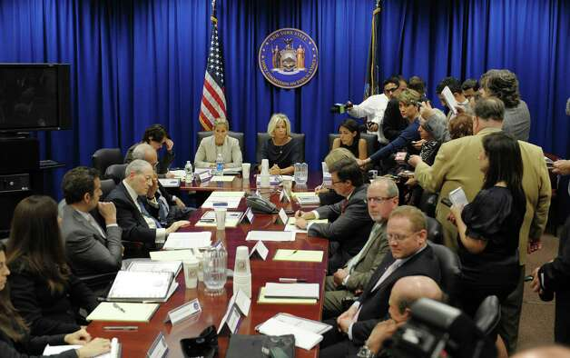 Journalists crowd around the table to hear as members of the New York State Joint Commission on Public Ethics hold a meeting on Monday, Sept. 10, 2012 in Albany, NY.   (Paul Buckowski / Times Union) Photo: Paul Buckowski