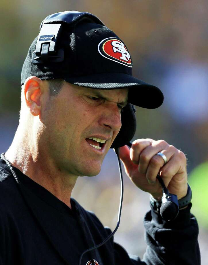 San Francisco 49ers head coach Jim Harbaugh reacts during the first half of an NFL football game  against the Green Bay Packers Sunday, Sept. 9, 2012, in Green Bay, Wis. (AP Photo/Jeffrey Phelps) Photo: Jeffrey Phelps