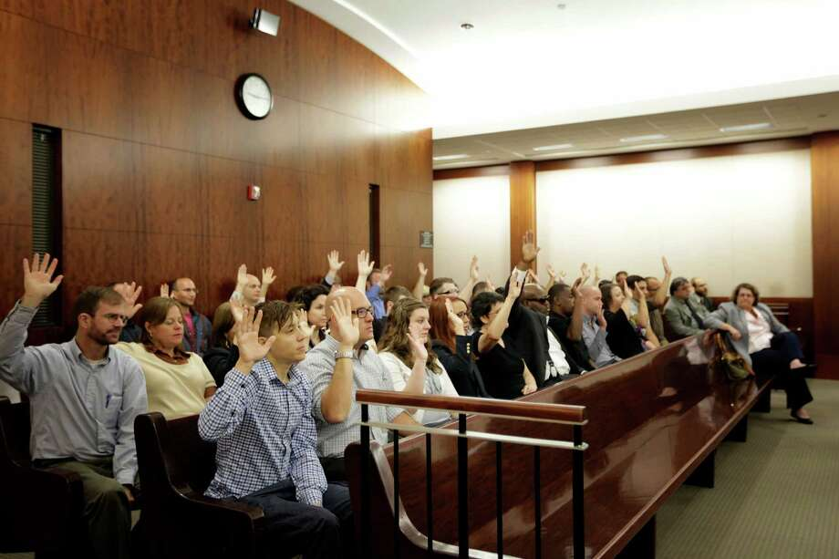 Union activists- most of whom flew in from around the nation - fill the courtroom Monday for their sentencing in connection with protests in support of janitors. Photo: TODD SPOTH / Todd Spoth