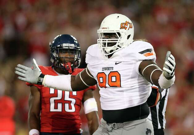 Defensive tackle Calvin Barnett (99) of  Oklahoma State reacts to a penalty call during the first quarter of the college football game against Arizona  at Arizona Stadium on September 8, 2012 in Tucson, Arizona.  Christian Petersen/Getty Images Photo: Christian Petersen, Getty Images / 2012 Getty Images