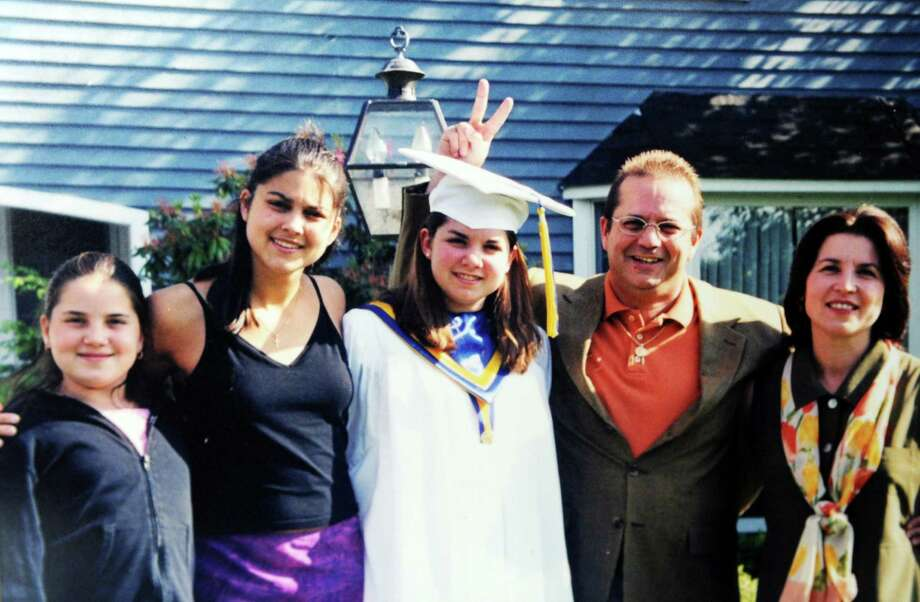 Pictured in a family photo, from left, are Alexandra, Jessica, Rebecca, Randy, and Denise Scott. The Scott family recently received a letter Randy wrote and threw from a window of Two World Trade Center before he died. The family has loaned the letter to the National September 11 Memorial & Museum. Photo: Contributed Photo / Stamford Advocate Contributed