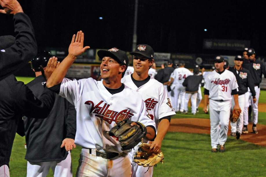 Tri-City Valleycats shortstop Joe Sclafani and teammates celebrate their 16-7 victory over the Auburn Doubledays in the deciding game of their NY-Penn League semifinal playoff series at Joseph Bruno Stadium on Monday night Sept. 10, 2012 in Troy, NY.  They will play Hudson Valley in the final.  (Philip Kamrass / Times Union) Photo: Philip Kamrass / 00019159A
