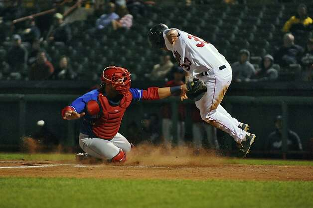 Auburn Doubledays catcher Spencer Kieboom tags out Tri-City Valleycats Preston Tucker while trying to score on a sacrifice fly in the bottom of the fifth during the deciding game of their NY-Penn League semifinal playoff series at Joseph Bruno Stadium on Monday night Sept. 10, 2012 in Troy, NY.    (Philip Kamrass / Times Union) Photo: Philip Kamrass / 00019159A