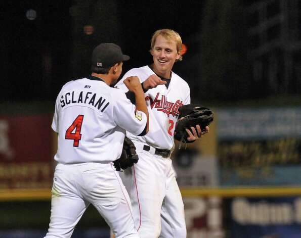 Tri-City Valleycats shortstop Joe Sclafani, left, congratulates first baseman Jesse Wierzbicki, right, at the start of the eighth inning as they head to their positions, after Wierzbicki's bases clearing double in the bottom of the seventh inning to make the score 10-6, during their 16-7 victory over the Auburn Doubledays in the deciding game of their NY-Penn League semifinal playoff series at Joseph Bruno Stadium on Monday night Sept. 10, 2012 in Troy, NY.  They will play Hudson Valley in the final.  (Philip Kamrass / Times Union) Photo: Philip Kamrass / 00019159A