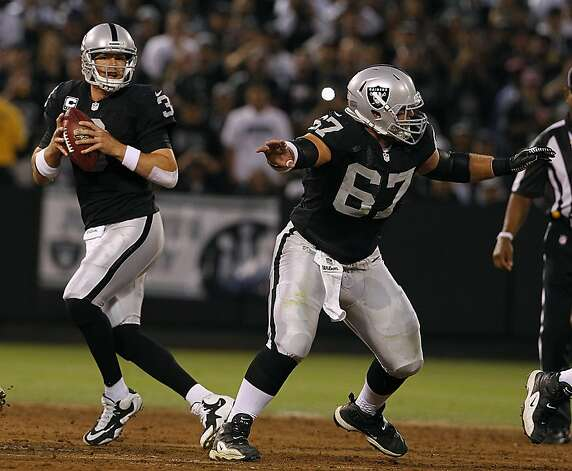 Carson Palmer gets pass protection from Alex Parsons in the first quarter of the Oakland Raiders game against the San Diego Chargers in Oakland, Calif. on Monday, Sept. 10, 2012. Photo: Paul Chinn, The Chronicle